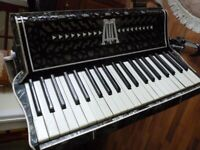 selling my fathers beautiful lombardi italia full size 120 bass accordian with stand..