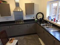 Kitchen work tops , cooker and extractor , sink all new