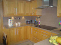 SOLID OAK FITTED KITCHEN WITH MINERAL WORKTOPS