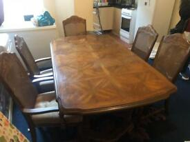 Table and six dining chairs in good condition