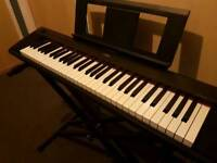 Excellent condition like new Yamaha keyboard with stand