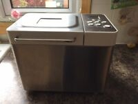 Breadmaker Kenwood with manual and recipe books. Excellent condition, hardlY used.