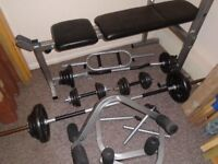 Metal weights and weight bench.