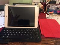 mini ipad with logitech ultrathis blue tooth keypad AND ipad mini apple magnetic cover (red)