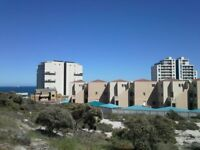 Visiting Cape Town soon? Holiday apartment with swimming pool close to beach. In Westbeach area.