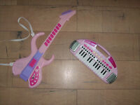 Musical instruments for a girl: Electric Toy Guitar in pink and Carry Along Keyboard also in pink