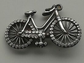 1890's Victorian silver brooch in the form of ladies safety bicycle.