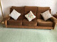 Brown low 3 Piece suite with settee, 2 x Armchairs & footstool