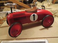 Toy ride on racing car , has only been used inside at grandparents house.