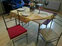 Dining table and set of chairs