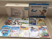 Nintendo Wii plus 6 in 1 sports pack, plus 10 games