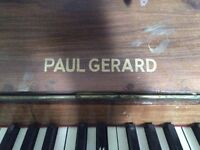 Upright wooden piano needs a new home
