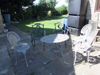 Cast metal garden chairs and table