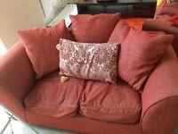 2 x orange 2 seater sofas