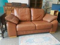 Tan leather two seater sofa