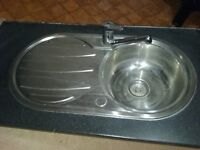 Round kitchen sink and drainer complete with monoblock tap