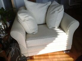 Elegant hand made, large cream armchair with 3 feather cushions-very comfortable