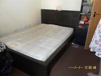 Black Ikea Malm double bed frame plus drawers on one side plus Ikea Sultan foam mattress