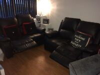 X2 two seater black faux leather reclining sofa's