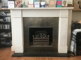 Plain light stone fireplace surround. Good condition- no longer needed.