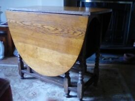 Old oak gateleg table . Very useful as can seat six when out full.