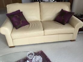 Large Italian handmade leather cream three piece suite and footstall.