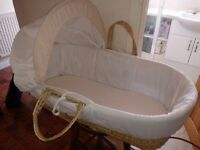 Unisex Moses basket with 3 cream sheets, 1 white sheet, 2 rocking stands and a folding still stand