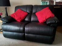 2 x 2 seater black leather settee fully reclinable
