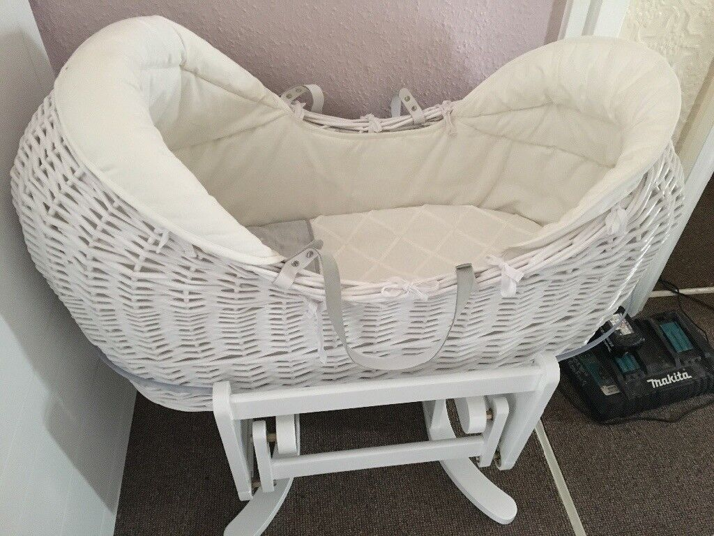 Mamas and papas Moses basket and mothercare gliding stand