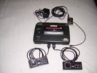 SEGA Master system II with 8 games including Alex Kidd built in. 2 controllers. Full working order