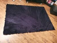 2 x black shaggy rugs