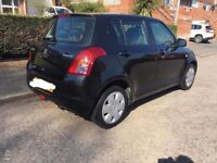 Black 2009 1.3 Suzuki Swift 5 doors. Perfect first car with low mileage and running costs