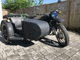 CJ 750 Motorbike with side car on right. 1985 model but registered in UK in 2014