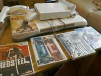 Nintendo Wii plus balance board and games