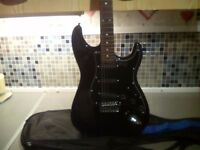 Black electric guitar £35 cash