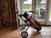 Golf clubs and matching trolley for a child
