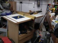 HOME MADE ROUTER TABLE WITH RYOBI INDUSTRIAL ROUTER AXMINSTER LIFT MECHANISM AND ICRA TWIN FENCE