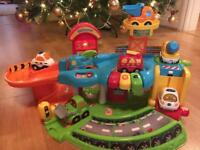Vtech toot toot garage and 7 interactive cars