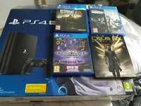 Ps4 pro fully boxed with 2tb hard drive and 4 games.