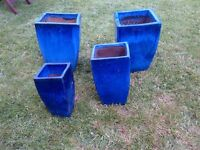 a set of four beautiful glazed flower pots in pristine condition