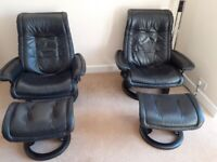 Two black Stressless chairs and foot stools