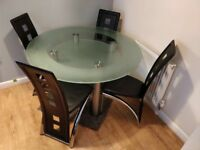 Glass Dining Table and Chrome/Black Chairs