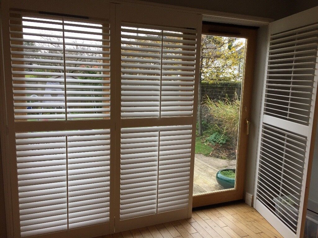 Plantation shutters for French Patio Doors. White, wood, good condition.