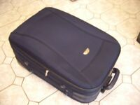 Pull-along Expanding Suitcase ....