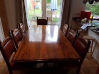 Dining table, 8 chairs, sideboard and side table. Mukwa hardwood from Zimbabwe.