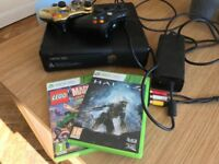 Xbox 360 plus two controllers and two games