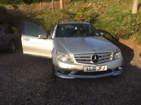 Low mileage good condition Mercedes Benz C180 Kompressor in silver. Taxed and MOT to September