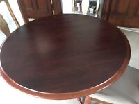 Round slid wood dining table and 4 chairs - can be delivered
