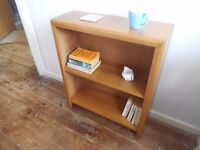 "Small solid wood bookcase, 2' 4"" high x 2' wide x 9"" deep."