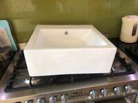 White ceramic square basin